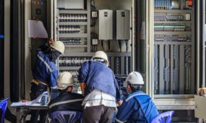 guys working on electrical equipment